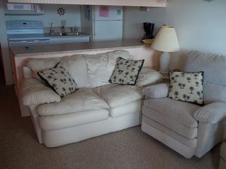 Treasure Island condo photo - Kitchen in background with living room couch & chair.