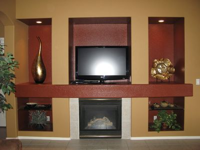 Main floor fireplace and TV.