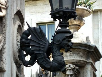 Gargoyle lamps on gates to Palazzo Barberini.