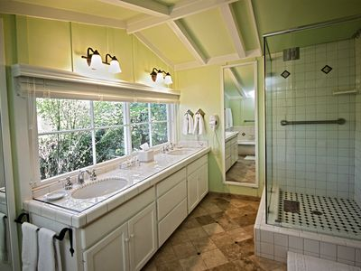 Upstairs bathroom with double sinks, separate shower and tub.