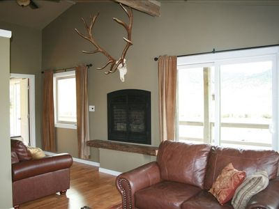 The living room has large picture windows and patio door leading to the porch.