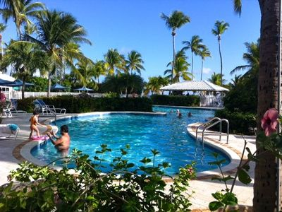 East End condo rental - The pool, hot tub, & beach bar are just a few feet from the Caribbean Sea.