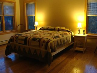 West Wardsboro house photo - Spacious Master Bedroom features luxurious queen bed and warm red oak floor.