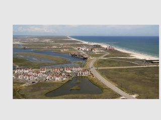 North Padre Island condo photo - Ariel view of condo , pond and Whitecap Beach