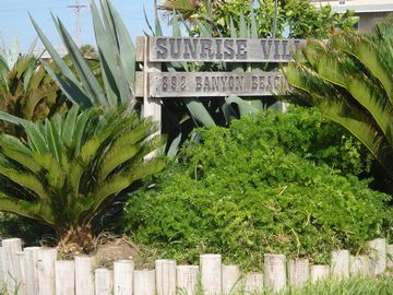 Landscaped entrance to Sunrise Villa Condominiums