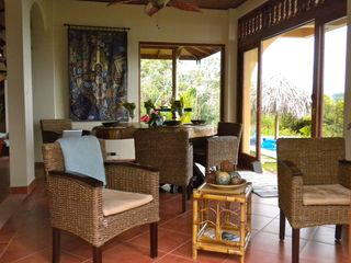 Uvita villa photo - Dining room overlooking the gardens, pool, ocean, sunrise and tropical sunsets.