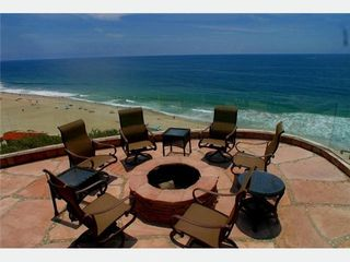 Malibu house photo - Blufftop deck with fireplace, grill and lounge chairs, great for whale watching.