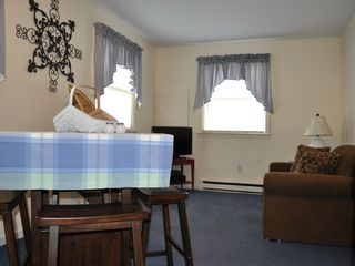 Lake George house photo - Cottage living room/eating area with twin sofa bed (sleeps 1)
