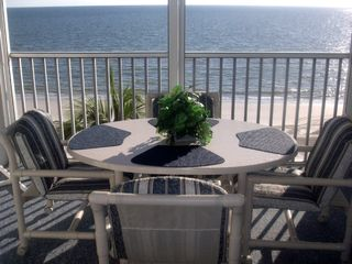 Fort Myers Beach condo photo - View of the Gulf from the screened lanai