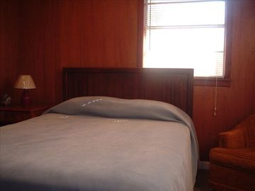 Queen size bed with adjoining full bath.