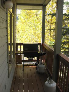 Weber Gas Grill on Covered Deck off Dining Room