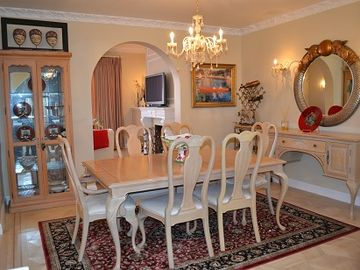 Dining room with Italian chandelier and sconces. Designer touches thru-out.