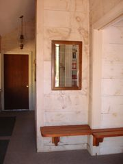 Weston house photo - Entrance hall with bench and hooks for many winter coats.
