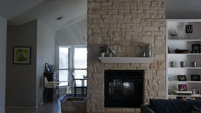 Living Room- Vaulted ceilings, lots of natural light, Plus a fireplace!