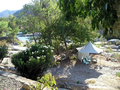 Guests enjoy cabanas by the Kaweah River