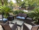 Private patio with seating and lighting overlooking W. 6th Street