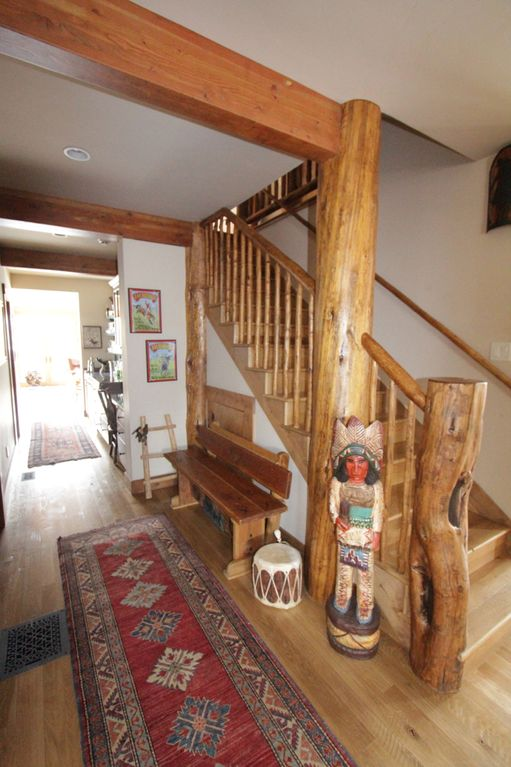 Front hall and stairway, western art, log accents