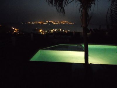Nighttime views include the twinkling distant lights of St. Thomas