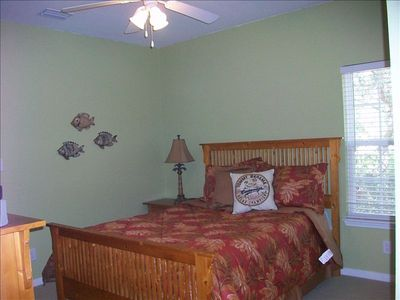 Queen size master bedroom with full bathroom and TV