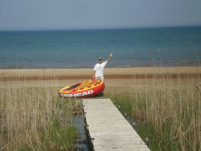 Oscoda house rental - Airhead holds 4 people comfortably. More airheads and lots of floaties!