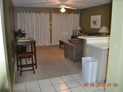Destin condo rental - View from hallway of Living Room. The Back Door opens to Patio, Pool & Beach.