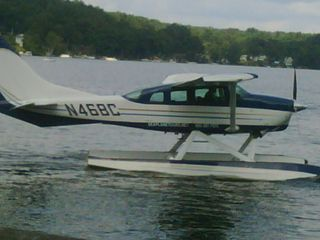 Laconia townhome photo - Pontoon Plane landing on Lake Winnipesaukee, Meredith, NH