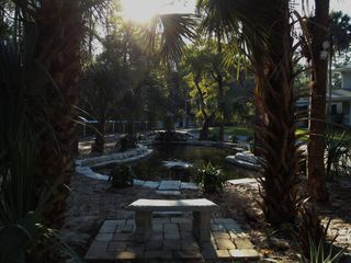 Naples house photo - pond with waterfall, fountain and stone bench for reading or contemplation