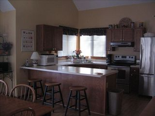 Galena house photo - Modern Kitchen with Stainless Steel appliances and breakfast bar