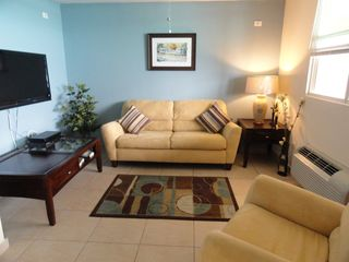 Aguadilla condo photo - Studio room with sleeper sofa with privacy curtains