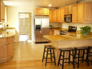 Brewster house photo - Large kitchen with Granite counters and New stainless steel Appliances.