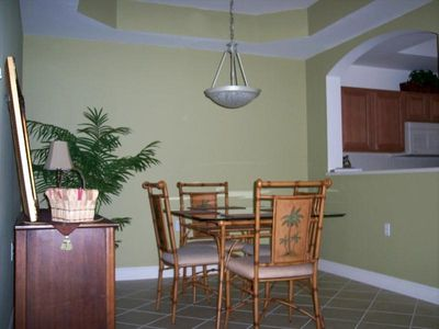 Dining room with trayed ceiling and pass through arch from spacious kitchen