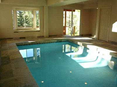 Swimming pool room w/ Sauna, Steam shower and deck right outside with a hot tub.