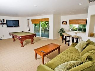 Large entertainment room, pool table, wet bar and access back patio . 1st floor - Carlsbad house vacation rental photo
