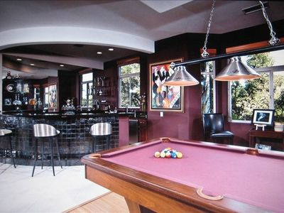 Relax at the bar and have a drink while playing a game of pool