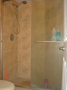Renovated bathroom with massaging showerhead