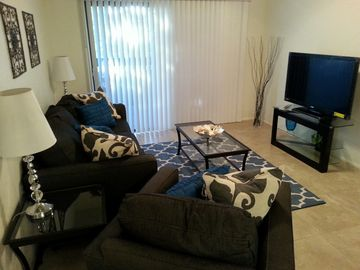 Tempe condo rental - Living room with 46' LCD TV. Cozy seating for 4. Private balcony access through sliding glass door. Balcony seating provided for two.
