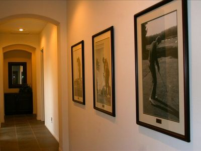 "Hallway with ""Legends of Golf"" photos"