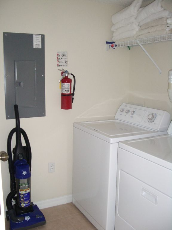 laundry room with washer dryer, iron and board
