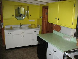 Lake Placid house photo - kitchen is fully stocked and includes a dishwasher