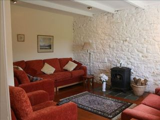 "County Mayo cottage photo - Family living/TV room with wood burning stove and ""dimmer lighting""."