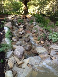 New waterfall cascading from the top of the front yard to the bottom.
