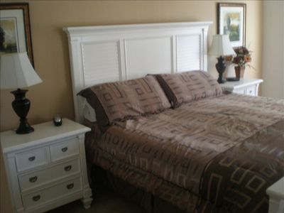 Master Bedroom with King size bed which faces large new flat screen Television