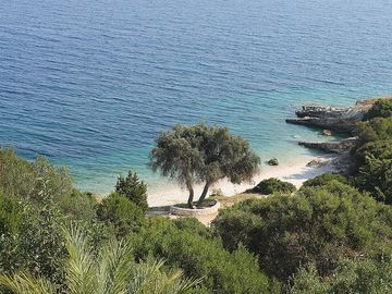 A little perfect beach is just below the villa
