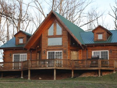 Back view of Sweet Life cabin with plenty of patio seating and gas grill.