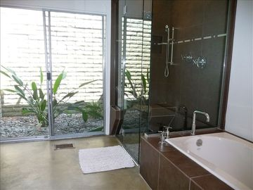 Private Master Bath off Master Bedroom and has its own atrium. Walk in shower.