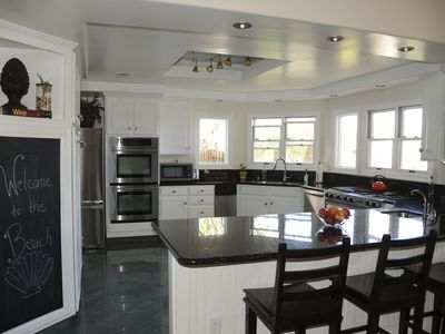 Kitchen-double ovens, large refrigerator with ice and filtered water,bar seating