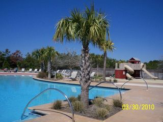 Port St. Joe house photo - Large pool and playground will keep your family cool and happy!