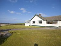 Spacious detached bungalow in delightful rural setting with large enclosed garden and distant sea views