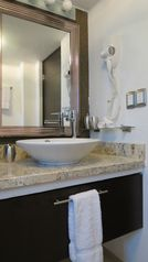 Puerto Vallarta apartment photo - Bath room with shower, granite counter andhair dryer