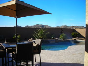 Buckeye house rental - Enjoy a meal poolside or relax by the fire pit and watch the sun set.